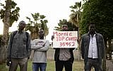 Illustrative image of African asylum seekers attending a memorial ceremony to commemorate 14 years since the genocide in Darfur, at Levinsky Park in southern Tel Aviv on Thursday, April 27 2017. (Tomer Neuberg/Flash90)