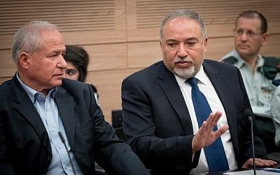 Defense Minister Avigdor Liberman (R) and head of the Knesset's Foreign Affairs and Defense Committee Avi Dichter in the Knesset on June 26, 2017. (Yonatan Sindel/Flash90)