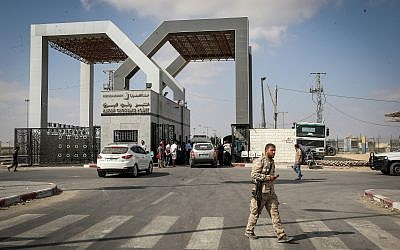 Palestinians wait to cross into Egypt through the Rafah border crossing in the southern Gaza Strip, on August 16, 2017. (Abed Rahim Khatib/Flash90)