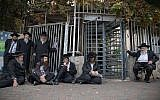 Ultra-Orthodox men holding a sit-in in front of an army recruitment center in Jerusalem, on November 28, 2017. (Flash90)