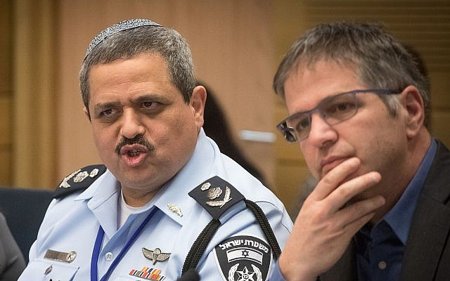 Police Commissioner Roni Alsheich (L) and Likud MK Yoav Kisch at the Knesset Internal Affairs Committee, February 5, 2018. (Miriam Alster/Flash90)
