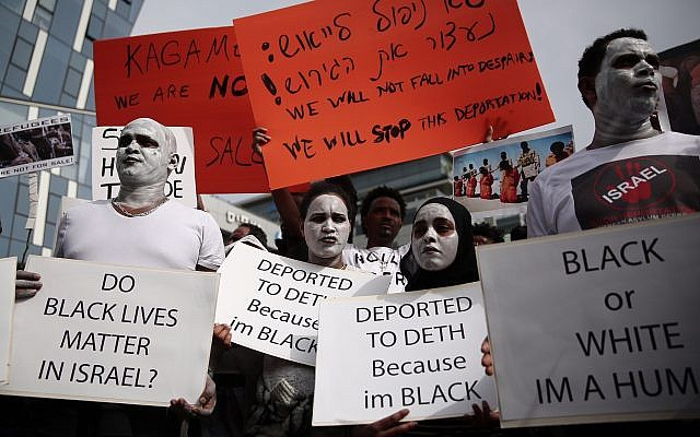 African asylum seekers and rights activists protest against deportation in front of the Rwandan Embassy in Herzliya, on February 7, 2018. (Miriam Alster/Flash90)