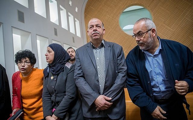 The parents of Mohammed Abu Khdeir seen with Arab-Israeli parliament member Saadia Osama (R) as they arrive at the Supreme Court in Jerusalem, on February 7, 2018. (Yonatan Sindel/Flash90)