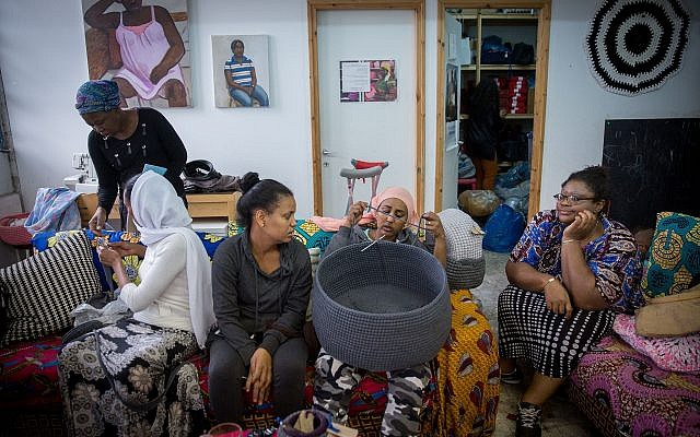 Women of the Kuchinate Collective crochet baskets in their workshop in south Tel Aviv on December 20, 2017. (Miriam Alster/Flash90)