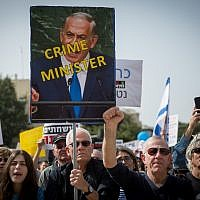 Israelis attend a weekly protest against public corruption in Tel Aviv on February 16, 2018 (Miriam Alster/Flash90)