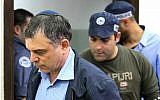 Shlomo Filber, director-general of the Communications Ministry, arrives for extension of his remand in Case 4000 at the Magistrate's Court in Rishon Letzion, February 18, 2018. (Flash90)