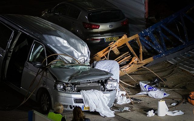 The Scene where a crane collapsed on a car in Kfar Saba on February 18, 2018, The driver, a 52-years-old woman died on the scene. (Roy Alima/Flash90)