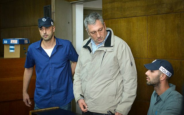 Nir Hefetz arrives for extension of his remand in case 4000 at the District Court in Tel Aviv, February 22, 2018. (Flash90)