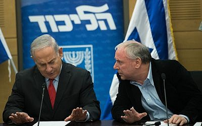 Prime Minister Benjamin Netanyahu with Coalition head David Amsalem at a Likud party faction meeting at the Knesset on February 26, 2018. (Yonatan Sindel/Flash90