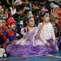 Young Israeli children dressed up in costumes for the Jewish holiday of Purim at a school in northern Israel, on February 27, 2018.  (Anat Hermony/Flash90)
