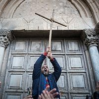 Protestors demonstrate outside the closed doors of the Church of the Holy Sepulchre in Jerusalem's Old City on February 27, 2018. (Yonatan Sindel/Flash90)