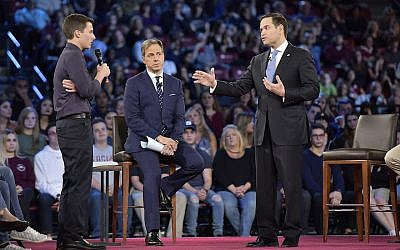 Illustrative: Marjory Stoneman Douglas student Cameron Kasky asks Sen. Marco Rubio (R-Fla.), right, if he will continue to accept money from the NRA during a CNN town hall meeting on February 21, 2018, at the BB&T Center, in Sunrise, Florida. (Michael Laughlin/Sun Sentinel/TNS via Getty Images via JTA)