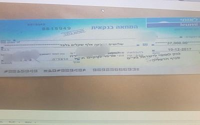 Forged check used to purchase secondhand goods, according to a police statement on February 19, 2018. (Israel police)