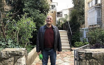 Gil Hovav in front of his childhood home in Jerusalem. (Jessica Steinberg/Times of Israel)