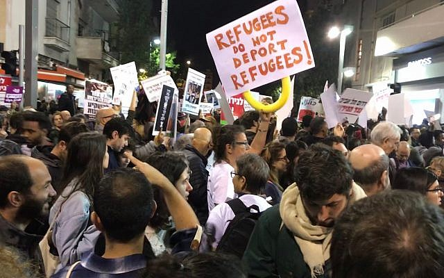 Protesters march in a demonstration in south Tel Aviv against Israel's planned deportation of African migrants and refugees, February 24, 2018. (Miriam Herschlag/ Times of Israel)