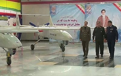 Screen capture from video showing Iranian Defense Minister Brigadier General Amir Hatami, left, during the opening of a production line to produce Iran's Mohajer 6 drone, in Tehran, February 5, 2018. (YouTube)