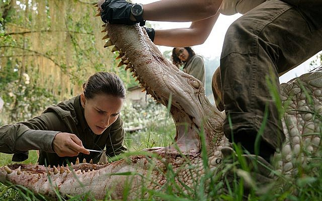 Natalie Portman tinkers with a mutant crocodile in 'Annihilation.' (Paramount Pictures)