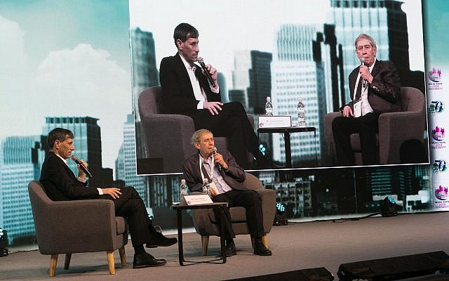 Photo of Tamir Pardo, right, former director of Mossad, speaking to attendees at The Federation of Local Authorities second bi-annual conference at the Tel Aviv convention center on Feb 13. (Courtesy)