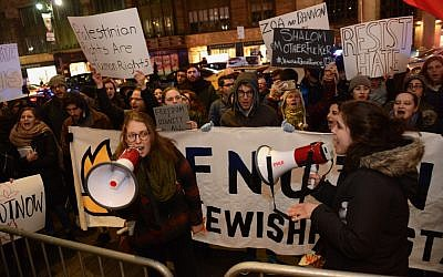 Naomi Hornstein (left) and Molly Schulman holding megaphones at an If Not Now protest outside the Zionist Organization of America gala in New York City. (Gili Getz)