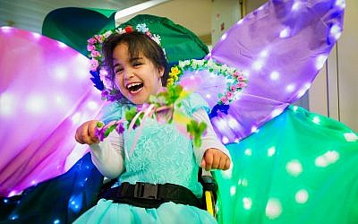 Yarden, a pleased fairy in her sparkling costumed wheelchair at Beit Issie Shapiro (Courtesy Beit Issie Shapiro)