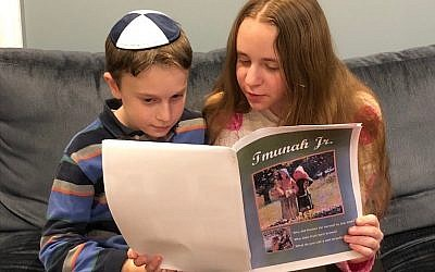 Rena, (age 13) reading Tmunah Jr. to her brother Ari (age 10).