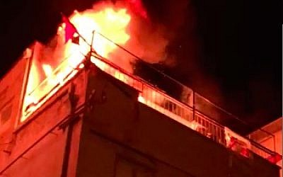 A fire breaks out in the Balad faction headquarters in Tel Aviv on January 31, 2018. (Screen capture/Omri Barens)