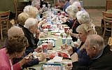 Seniors from Sun City in Palm Springs, California gather for Shabbat dinner at their local Wendy's fast food restaurant, as seen in 'Wendy's Shabbat' short documentary film (Courtesy of 3 Penny)