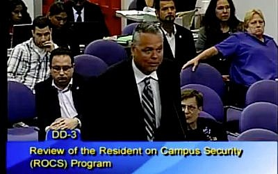 This Feb. 18, 2015 image taken from video provided by Broward County Public Schools shows school resource officer Scot Peterson during a school board meeting of Broward County, Fla.  (Broward County Public Schools via AP)