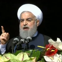 Iranian President Hassan Rouhani addressing a crowd of hundreds of thousands in Tehran on the 39th anniversary of the Islamic Revolution on February 11, 2018. (Screen capture: YouTube)