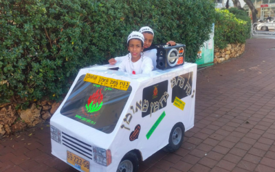 Two kids from Kiryat Gat dress up for Purim as Na Nachs, Breslov Hasidim who often travel around in white vans, dancing in the streets to techno music (Courtesy Facebook)