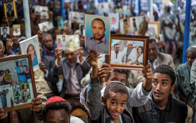 Members of Ethiopia's Jewish community hold pictures of their relatives in Israel, during a solidarity event at the synagogue in Addis Ababa, Ethiopia, February 28, 2018. (AP Photo/Mulugeta Ayene)