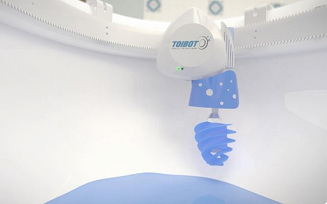 A Toibot prototype installed inside toilet bowl. (Courtesy)