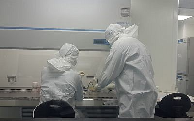 Scientists work in a sterile environment preparing regrown bone for Bonus BioGroup. (Sivan Geffen/Times of Israel)