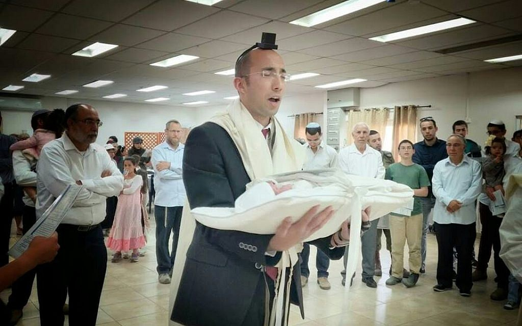 Itamar Ben-Gal, who was killed in a stabbing attack in the West Bank, February 5, 2018, pictured here at the circumcision of his son in 2017 (Yitzhak Melamed)