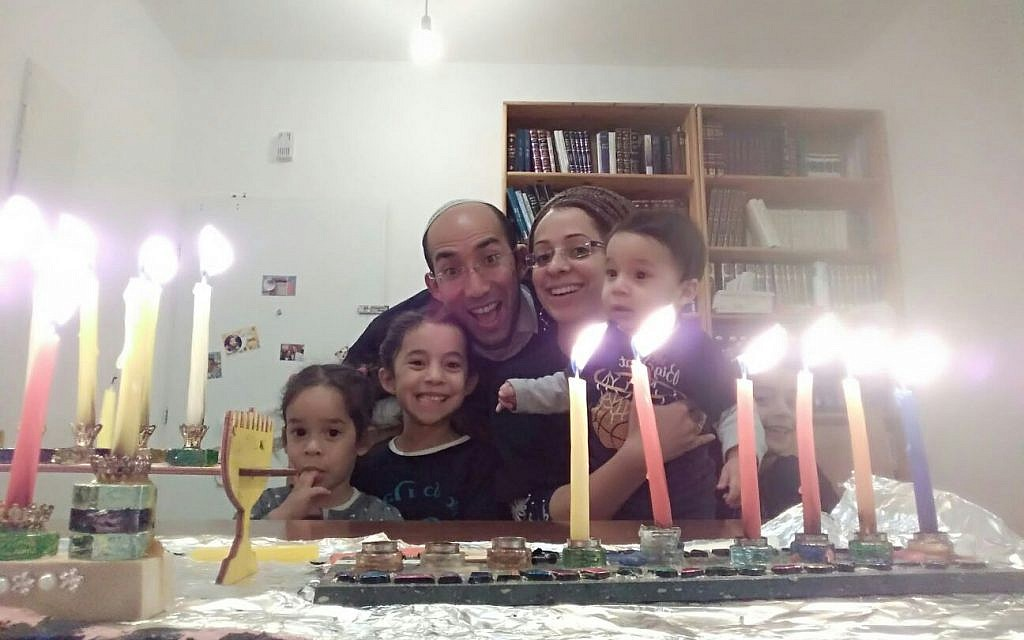 Itamar Ben-Gal (third from L), who was murdered by a Palestinian terrorist on February 5, 2018, pictured with his family celebrating Hannukah in 2017. (Courtesy)