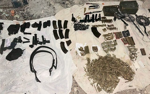 Guns, bullets and military equipment seized by Israeli soldiers in a pre-dawn raid in the village of Deir Razih, southwest of Hebron, on February 8, 2018. (Israel Defense Forces)