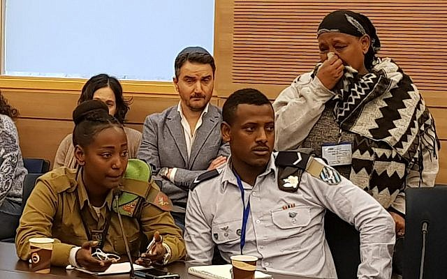 Ethiopian-Israeli activists plead with the Interior Ministry to allow their families to immigrate from Ethiopia at a State Control Committee meeting on February 12, 2018. (courtesy the Knesset)
