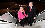 Prime Minister Benjamin Netanyahu and his wife Sarah Netanyahu board a plane at Ben Gurion Airport before departing for Munich, February 15, 2017. (Amos Ben Gershom/GPO)