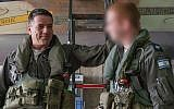 Head of the Israeli Air Force, Maj. Gen. Amikam Norkin, left, stands with Maj. 'Aleph,' the navigator of an F-16 fighter jet shot down by Syrian anti-aircraft fire, as the officer returns to fly for the first time since the crash, on February 19, 2018. (Israel Defense Forces)