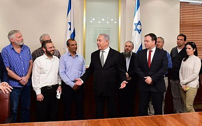 Prime Minister Benjamin Netanyahu (c) meets with settler leaders in his office on February 25, 2018. (Amos Ben Gershom/GPO)