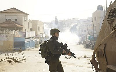 IDF troops operate in the Jenin area on February 3, 2018 in pursuit of Ahmad Jarrar, a suspect in the killing of Rabbi Raziel Shevach. (Israel Defense Forces)