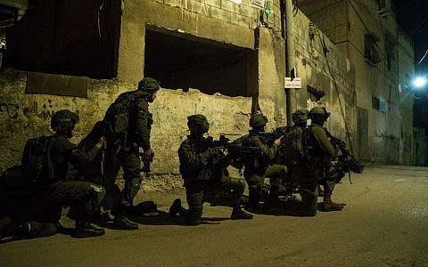 Illustrative: IDF soldiers search for the perpetrators of the terror attack that killed Rabbi Raziel Shevach in the northern West Bank village of Burqin, on February 4, 2017. (IDF spokesperson)