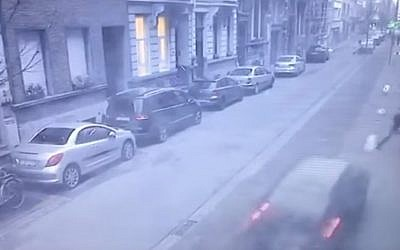 A man and his son diving to avoid a car heading toward them in Antwerp on February 3, 2018. Screen capture: YouTube)