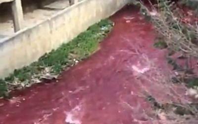Lebanon's Bardawni River, with its water turned red (YouTube screenshot)
