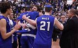 Basketball players in Yeshiva University Maccabees team celebrate their winning their first-ever Skyline Conference Championship on February 25, 2018. (Screen capture: YouTube)