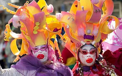 Participants at a traditional Carnival parade in Maastricht, the Netherlands, March 2, 2014. (Marcel Van Hoorn/AFP/Getty Images/via JTA)
