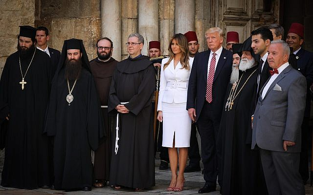 Church leaders gather around US President Donald Trump and his wife Melania at the Church of the Holy Sepulcher in the Old City of Jerusalem during the Trumps' visit to the city on May 22, 2017. The Greek Orthodox Patriarch can be seen to the left of the president. (Nati Shohat/Flash90