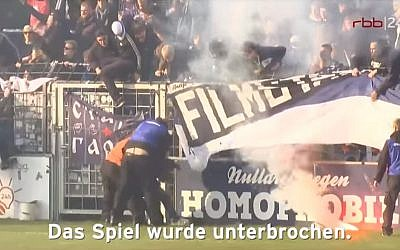 Security guards clash with Cottbus fans during a soccer match between SV Babelsberg and Energie Cottbus in Babelsberg, eastern Germany, on April 28, 2018. (YouTube screen capture)