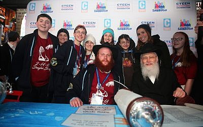 Rabbi Shaya Denburg, co-director of CTeen in Coral Springs, Florida, center, with other Cteen organizers and survivors of the Parkland, Florida, school shooting. (Itzik Roytman/Cteen)