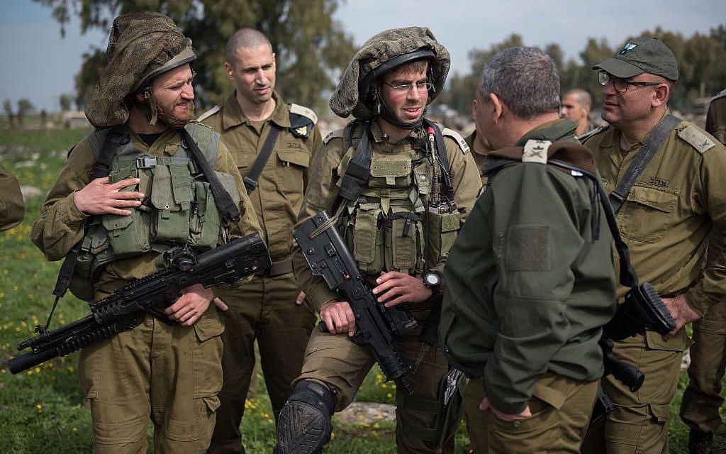 IDF Chief of Staff Gadi Eisenkot meets with soldiers taking part in a large exercise  in northern Israel meant to simulate war in Lebanon on February 20, 2018. (Israel Defense Forces)